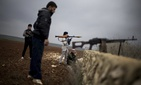 Free Syrian Army fighters take their positions, close to a military base, near Azaz, Syria, Dec. 10, 2012.