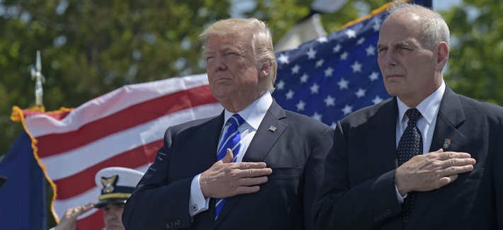 President Donald Trump and Homeland Security Secretary John Kelly listen to the national anthem during commencement exercises at the U.S. Coast Guard Academy in New London, Conn., on May 17, 2017.