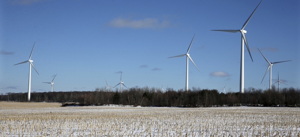Large energy producing wind turbines that make up Noble Ellenburg Windpark are seen on a harvested cornfield on a farm Sunday, Jan. 15, 2017, in Ellenburg, N.Y.