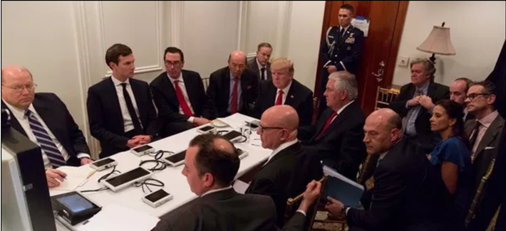 Donald Trump is shown in an official White House handout image meeting with his National Security team.