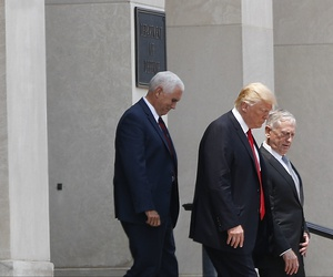 President Donald Trump and Vice President Mike Pence walk out with Defense Secretary Jim Mattis following Trump's visit to the Pentagon, Thursday, July 20, 2017.