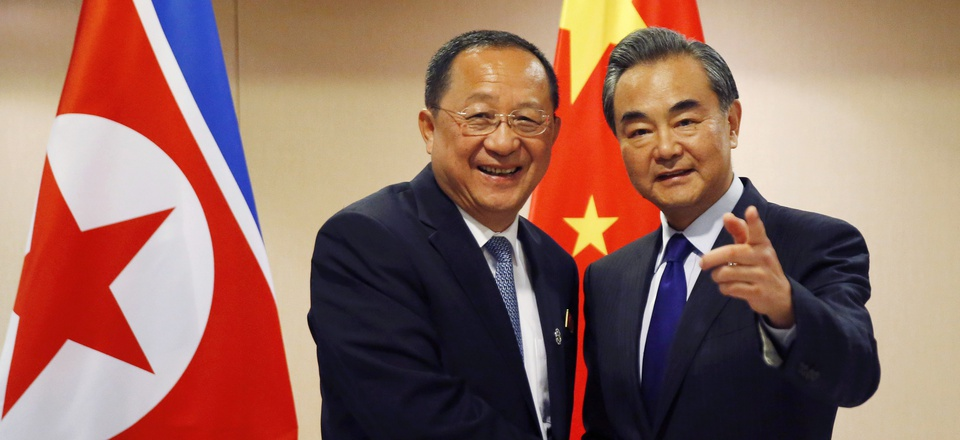 North Korean Foreign Minister Ri Yong Ho, left, is greeted by his Chinese counterpart Wang Yi prior to their bilateral meeting in the sidelines of the 50th ASEAN Foreign Ministers' Meeting August 6.