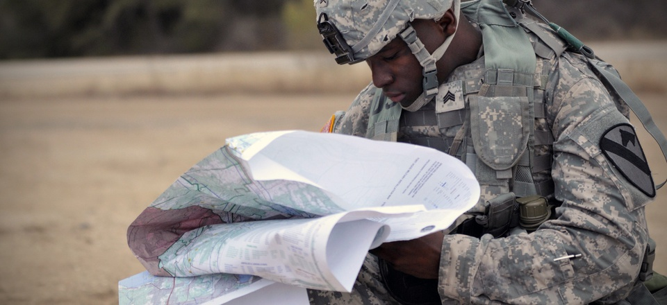 A soldier reviews maps earlier this year at Fort Hood, Texas.