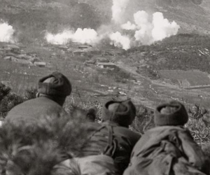 U.S. troops watch as white phosphorus is dropped on Communist positions during the Korean War in 1951.