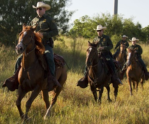Agents patrol on horseback in South Texas. The IG said wastefulness could hinder CBP's planned Border Patrol hiring spree.