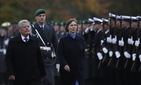 German President Joachim Gauck, left, and Estonia's President Kersti Kaljulaid, right, review the honor guard prior to a meeting at Bellevue Palace in Berlin, Friday, Nov. 11, 2016.