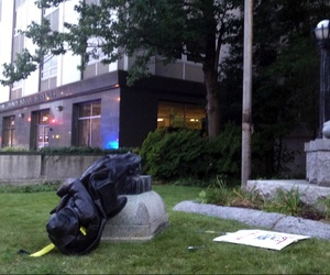 A toppled Confederate statue lies on the ground on Monday, Aug. 14, 2017, in Durham, N.C.