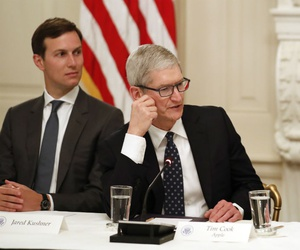 Apple CEO Tim Cook with President Donald Trump, right, and Jared Kushner, White House Senior Adviser, left, at an American Technology Council roundtable on June 19.