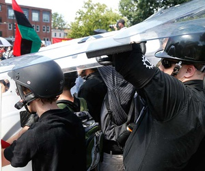 White nationalists hold shields as violence erupts in Charlottesville on Aug. 12.