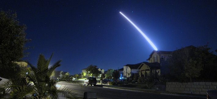 An operational test launch of an unarmed Minuteman III intercontinental ballistic missile from Vandenberg Air Force Base, Calif., is seen from nearby Lompoc, California in September 2013.