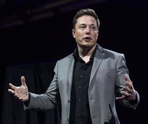 In this April 30, 2015, file photo, Tesla Motors CEO Elon Musk unveils the company's newest products, in Hawthorne, Calif.