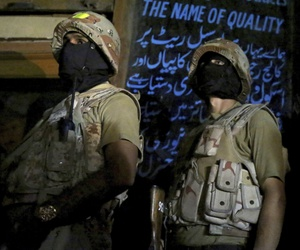 Pakistani paramilitary troops take position during a gunbattle with militants in Karachi, Pakistan in April.