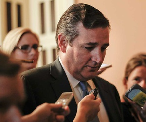 Cruz speaks to the media in July.