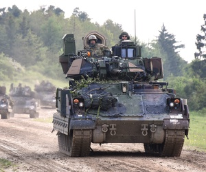 M2A3 Bradley Fighting Vehicles road march back to their tactical assemble area after a situational training exercise lane as a part of Combined Resolve VI at Hohenfels, Germany May 16, 2016.