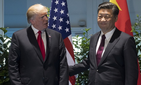 US President Donald Trump and Chinese President Xi Jinping, right, arrive for a meeting on the sidelines of the G-20 Summit in Hamburg, Germany, Saturday, July 8, 2017.