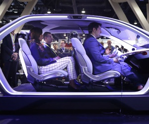 how attendees sit in the Chrysler Portal self-driving concept car at CES International Thursday, Jan. 5, 2017, in Las Vegas.
