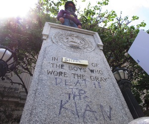 A protester looks down from where a Confederate statue once stood in front of the old Durham County Courthouse in Durham, North Carolina.