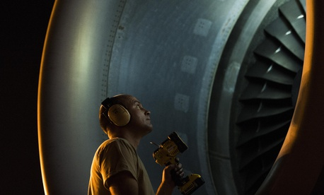 Tech. Sgt. Jonathan Carr, a crew chief with the 62nd Aircraft Maintenance Squadron, Joint Base Lewis-McChord, Wash., checks the engine of a C-17 Globemaster III during Exercise Mobility Guardian at Joint Base Lewis-McChord, Wash., Aug. 6, 2017.