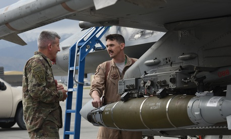 U.S. Army Gen. John Nicholson, commander of Resolute Support Mission and U.S. Forces Afghanistan, speaks with U.S. Air Force Maj. Greg Balzhiser, a F-16 Fighting Falcon pilot, at Bagram Airfield, Afghanistan, May 13, 2017.