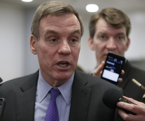 Senate Intelligence Committee Vice Chairman Sen. Mark Warner, D-Va. speaks to reporters on Capitol Hill in Washington, May 17, 2017.