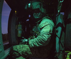 Master Sgt. Michael Berger, a special mission aviator from the 920th Rescue Wing, prepares for takeoff prior to a night flight on an HH-60G Pave Hawk helicopter July 6, 2017. The night exercise included a two-ship formation.