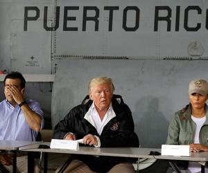 Puerto Rico Gov. Ricardo Rosselló, President Donald Trump and First Lady Melania Trump speak at Luis Muniz Air National Guard Base Tuesday.