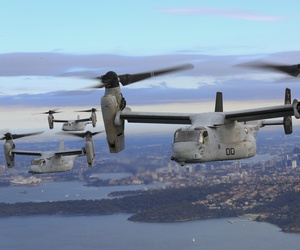 A set of MV-22B Osprey tiltrotor aircraft fly in formation above the Pacific Ocean off the coast of Sydney, Australia, June 29, 2017.