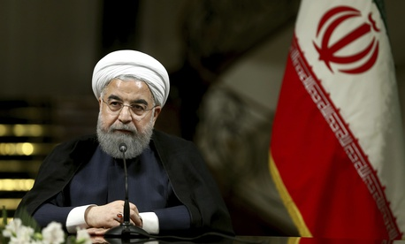 Iranian President Hassan Rouhani speaks with media at the Saadabad Palace in Tehran, Iran, on Oct. 4, 2017