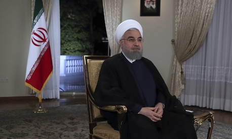 In this photo released by the official website of the office of the Iranian Presidency on Tuesday, Aug. 29, 2017, President Hassan Rouhani attends an interview with the state-run TV at the presidency office in Tehran, Iran.