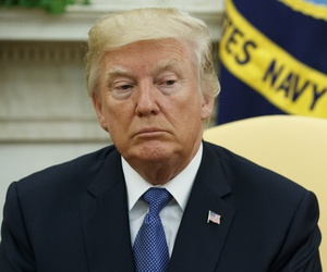 President Donald Trump listens as former Secretary of State Henry Kissinger speaks during a meeting in the Oval Office of the White House, Tuesday, Oct. 10, 2017, in Washington.