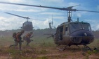 U.S. Army Bell UH-1D helicopters airlift members of the 25th Infantry Division, northeast of Cu Chi, South Vietnam, 1966.