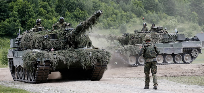 Two Leopard 2A4 tanks of Norway's armed forces take part in NATO's Enhanced Forward Presence in Lithuania in June 2017.