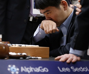 South Korean professional Go player Lee Sedol reviews the match after finishing the final match of the Google DeepMind Challenge Match against Google's artificial intelligence program, AlphaGo.