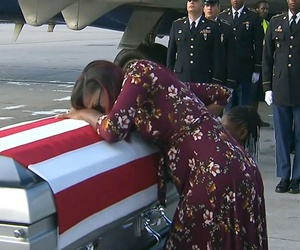 Myeshia Johnson cries over the casket of her husband, Sgt. La David Johnson, who was killed in an ambush in Niger, upon his body's arrival in Miami.