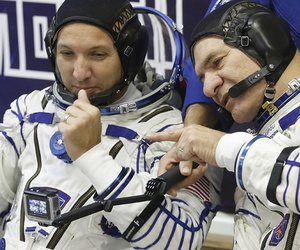 U.S. astronaut Randy Bresnik , left, and Italian astronaut Paolo Nespoli members of the main crew of the expedition to the International Space Station (ISS), look at a camera prior the launch of Soyuz MS-05 space ship.
