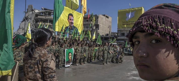 Fighters from the Women's Protection Units, or YPJ, say they will continue fighting for women. Here, they celebrate in Paradise Square, Raqqa, Syria, Thurs., Oct 19, 2017.
