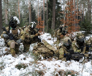 173rd Airborne Brigade paratroopers conduct a security halt during a foot patrol at the 7th Army Training Command's Grafenwoehr Training Area, Germany, Jan. 28, 2017.