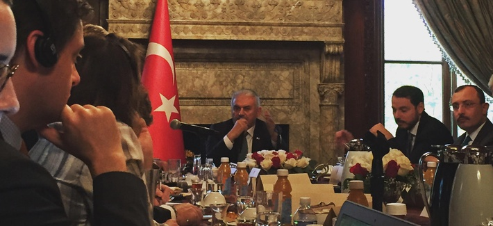 Turkey's Prime Minister Binali Yildirim speaks to reporters at the Turkish Embassy residence, in Washington, DC, Nov. 8, 2017.