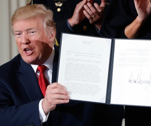 Donald Trump displays a presidential memorandum he signed, declaring the opioid crisis a public health emergency in October.