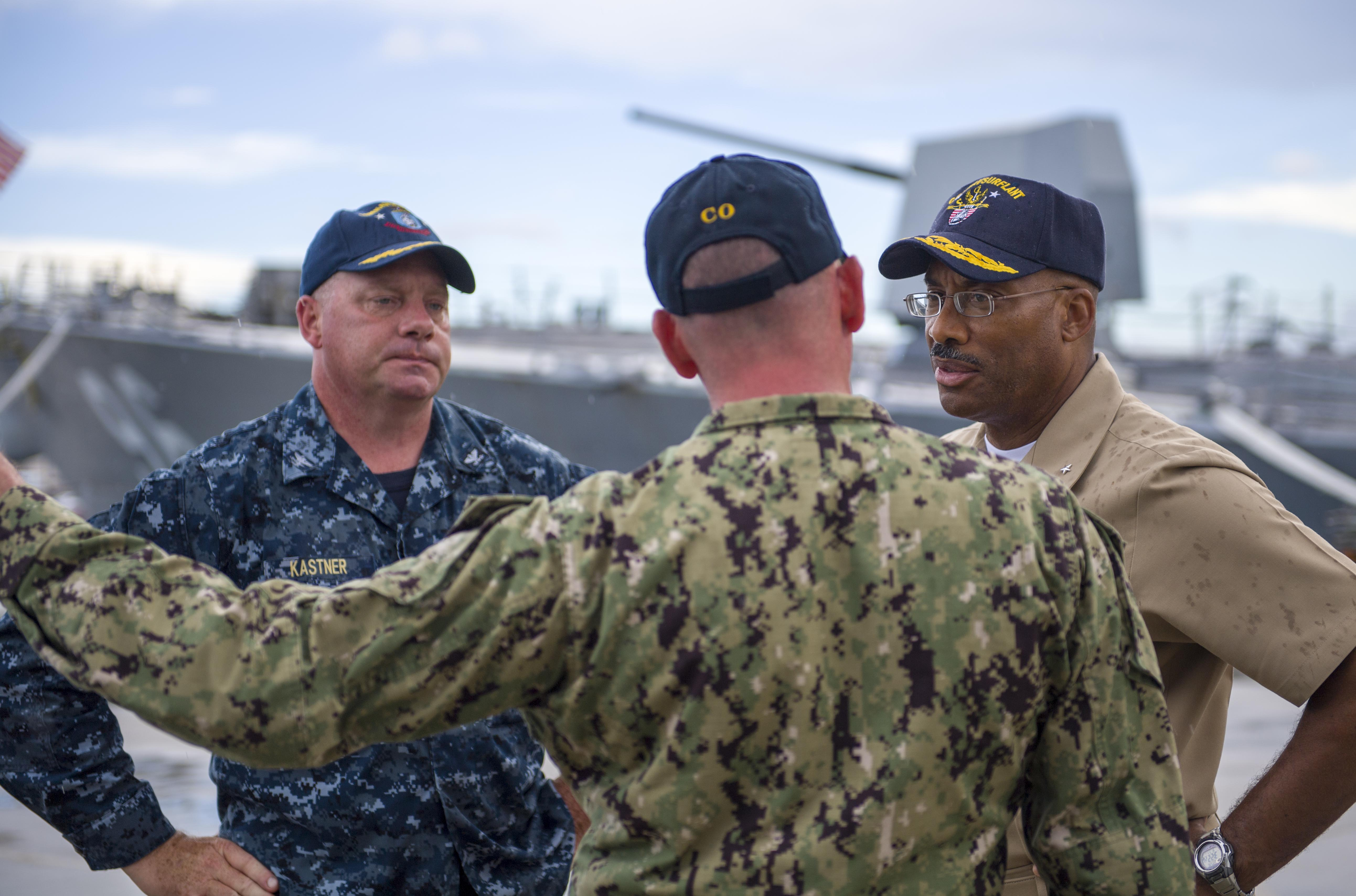 ac412e03425f15 Corey Keniston, center, commanding officer of the guided-missile cruiser  USS Gettysburg (CG 64), while inspecting heavy-weather ...