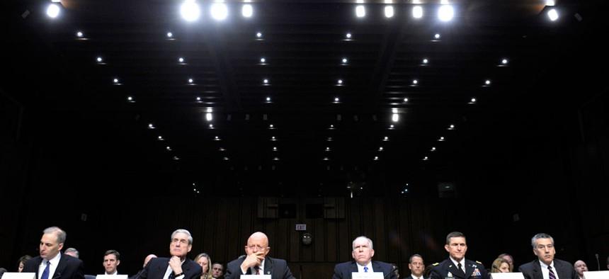 A Senate Intelligence Committee hearing features Defense Intelligence Agency Director Lt. Gen. Michael Flynn and CIA Director John Brennan.