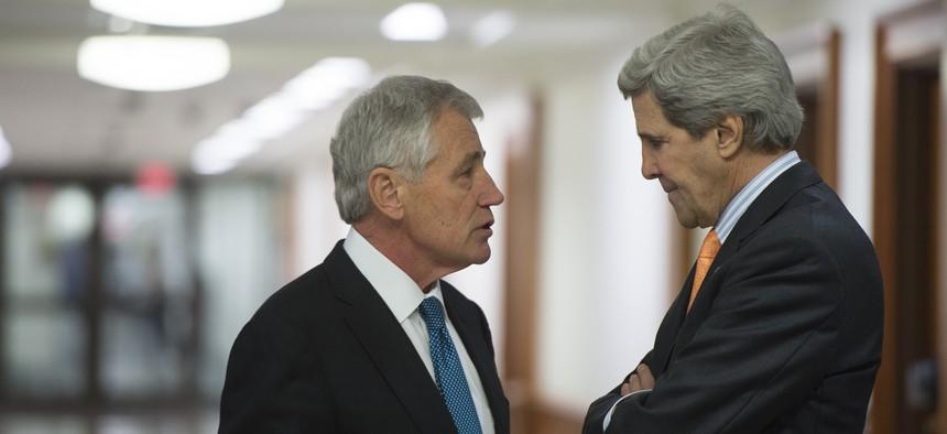 Defense Secretary Chuck Hagel and Secretary of State John Kerry.