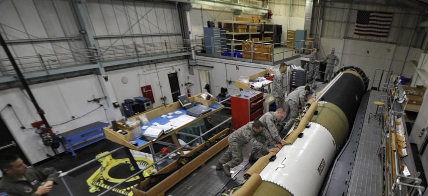 Airmen working on a Minuteman III ICBM at Vandenberg Air Force Base, Calif.