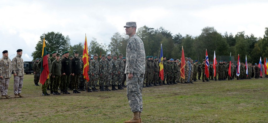 U.S. Army Lt. Col. Carleton Lee receives the report of 40 countries participating in exercise Combined Endeavor