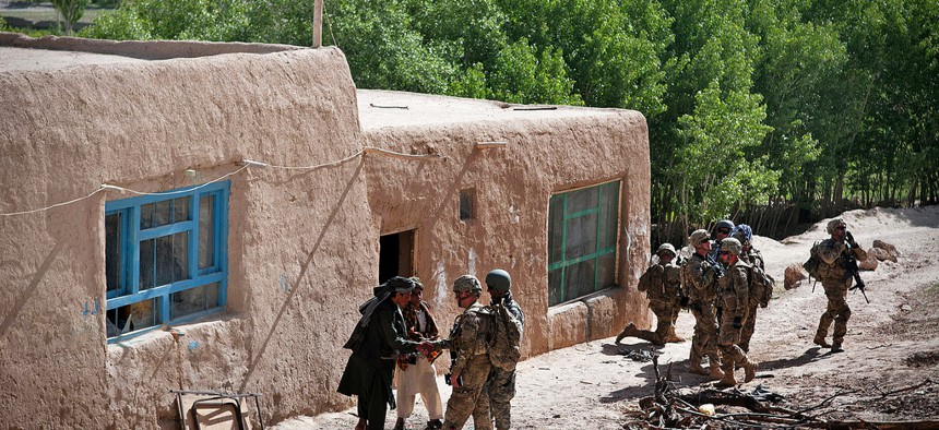 Paratroopers with the 82nd Airborne Division pull security outside a madrassa as Afghan soldiers search for weapons inside, on May 29, 2012.