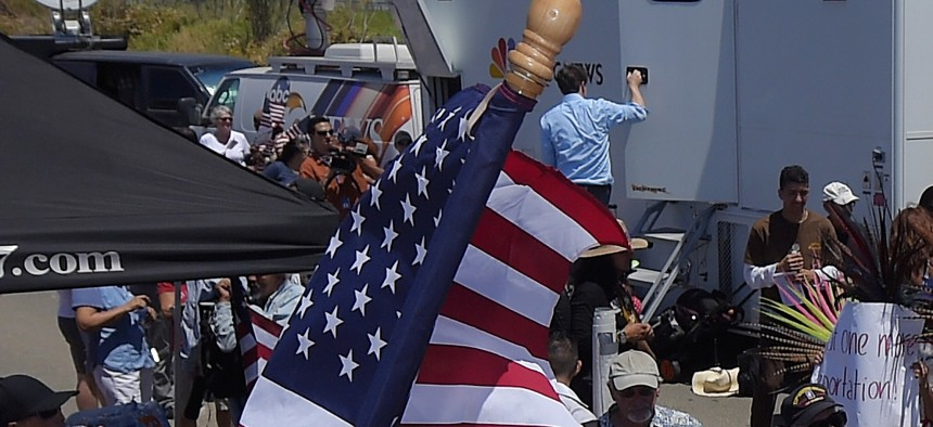 Protesters clash on July 4th, 2014, as the immigration debate heats up, at U.S. Border Patrol station in Murrieta, Calif.