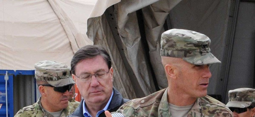 The Pentagon's top weapons buyer Frank Kendall tours a facility at Kandahar Airfield, Afghanistan, on February 9, 2014.