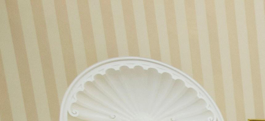 President Barack Obama meets with Senate Minority Leader Mitch McConnell of Ky., House Speaker John Boehner of Ohio, Senate Majority Leader Harry Reid of Nev., and House Minority Leader Nancy Pelosi of Calif., in the White House about ISIL, June 18, 2014.