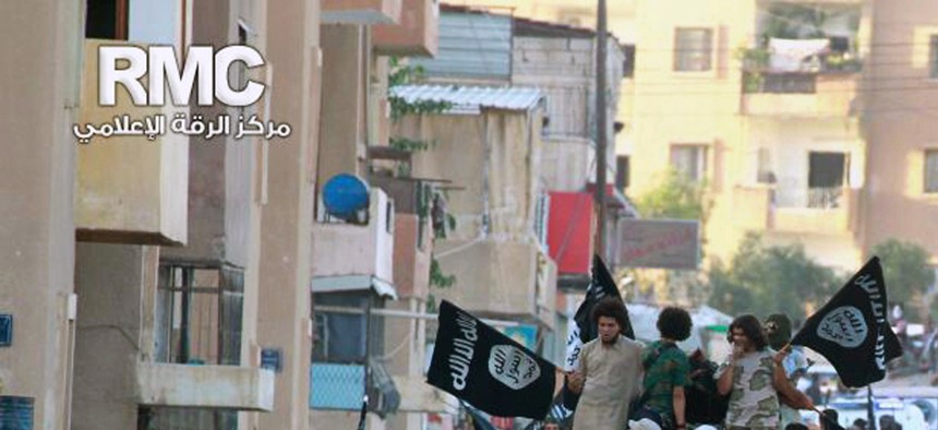 Fighters from the ISlamic State parade in the northern Syrian town of Raqqa, on June 30, 2014.