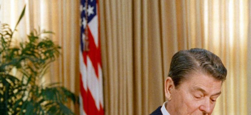 President Ronald Reagan checks his watch while talking to Soviet leader Mikhail Gorbachev in the White House.